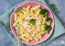 Pasta spirals with broccoli sauce served on a plate with a fork. The view from the top.  royalty free stock photo