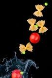 Pasta Splashing In Water royalty free stock images