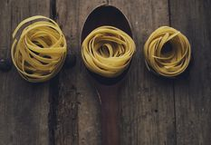 Food backround. Pasta in a spoon for recepies, vintage backround and food photography Royalty Free Stock Photos