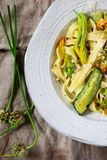 Pasta squash blossoms zucchini garlic flowers. Selective stock image