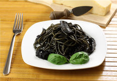 Pasta with squid ink. On wooden table Royalty Free Stock Image