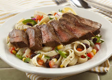 Pasta and steak Stock Image