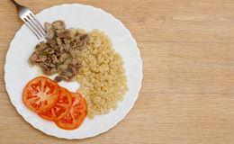 Pasta stew slices meat tomato plate Royalty Free Stock Photos