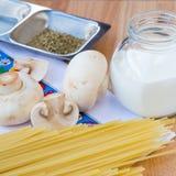 Pasta still-life. With spaghetti, cream and mushrooms Stock Photos