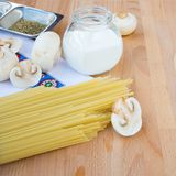 Pasta still-life. With spaghetti, cream and mushrooms Royalty Free Stock Image
