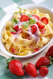 Pasta with strawberry cream Royalty Free Stock Images
