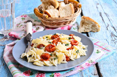 Pasta with sun dried tomatoes, cheese and thyme Royalty Free Stock Photography