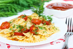 Pasta with sun-dried tomatoes and dill Stock Images