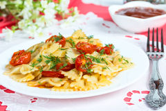 Pasta with sun-dried tomatoes Stock Photos
