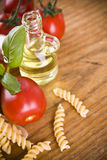 Pasta with sweet little tomatos green basil and olive from olives Royalty Free Stock Photos