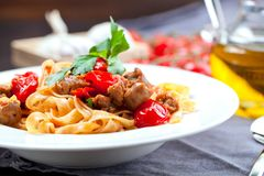 Pasta tagliatelle with beef bolognese sauce and parmesan. royalty free stock photo