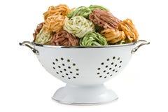 Pasta tagliatelle in colander Royalty Free Stock Image