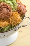 Pasta tagliatelle in colander Royalty Free Stock Photo