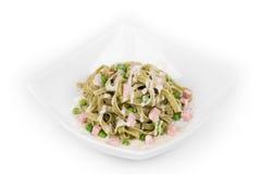 Pasta tagliatelle with green peas Stock Photo