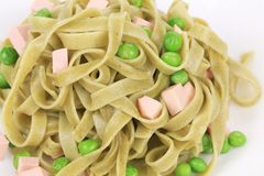 Pasta tagliatelle with green peas and ham. Royalty Free Stock Photos