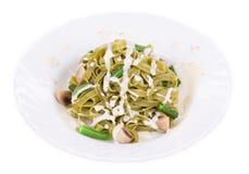 Pasta tagliatelle with green peas Stock Photos