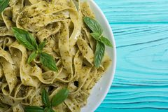 Pasta tagliatelle with green sauce pesto Italian food background. Pasta tagliatelle with green sauce pesto . Italian food background stock photo