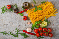 Pasta Tagliatelle and ingredients for cooking Royalty Free Stock Images