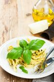 Pasta tagliatelle with pesto sauce and basil Royalty Free Stock Images