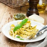 Pasta tagliatelle with pesto sauce and basil Royalty Free Stock Photo