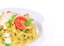 Pasta tagliatelle with pesto sauce and basil. Royalty Free Stock Photography