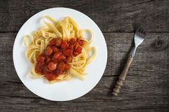 Pasta Tagliatelle with tomato sauce and debreziner sausages Stock Photo