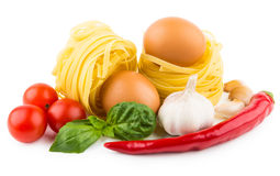 Pasta tagliatelle, tomatoes, garlic, chili pepper and basil leav Royalty Free Stock Image
