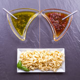 Pasta tagliatelle with tow sauces Royalty Free Stock Images