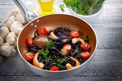 Pasta tagliolini ink squid Stock Photos