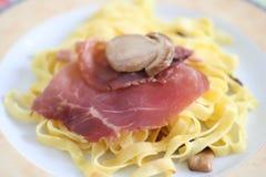 Pasta Teresa. Italian pasta\tagliatelles with a ham of Parma and mushrooms Royalty Free Stock Photography