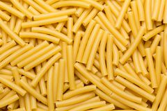 Pasta texture background. Different types of pasta rolled in a layer Royalty Free Stock Photography