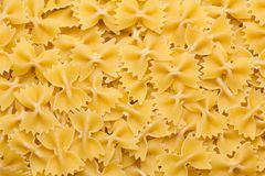 Pasta texture background. Different types of pasta rolled in a layer Stock Photo