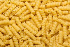 Pasta texture background. Different types of pasta rolled in a layer Royalty Free Stock Image