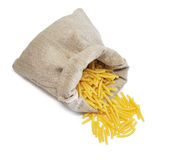 Pasta and textured bag Royalty Free Stock Photos
