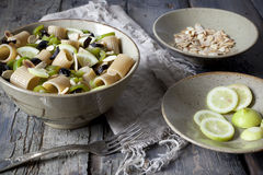 Pasta thai with lemon, almond, olive sliced and green pepperoni on bowl Stock Photography