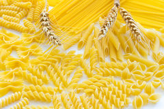 Pasta and three spikelets of wheat closeup Royalty Free Stock Photography