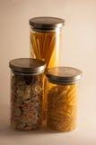 Pasta. Tipical mediterranean italian pasta in box of glass Stock Image