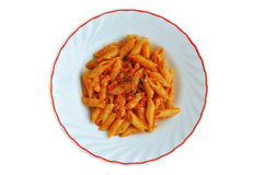 Pasta and tomato. Short pasta dressed with tomato sauce bacon and black pepper isolated Stock Photo