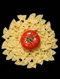 Pasta and tomato. Farfalle pasta and red tomato Stock Image