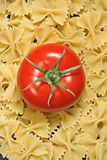 Pasta and tomato. Farfalle pasta and red tomato Stock Photos