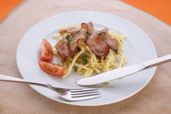 Pasta with tomato and bacon Stock Photo