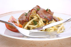 Pasta with tomato and bacon Stock Image