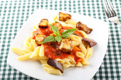 Pasta with tomato, basil and eggplant Royalty Free Stock Image