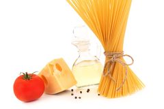 Pasta, tomato, cheese, carafe of oil and pepper Stock Image