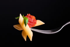 Pasta tomato on fork Royalty Free Stock Image