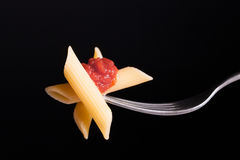 Pasta tomato on fork Stock Photos