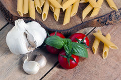Pasta, tomato and garlic Royalty Free Stock Image