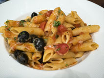 Pasta with tomato and olive sauce and parmesan Royalty Free Stock Photo