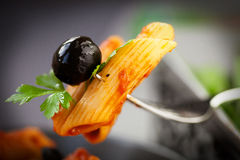 Pasta with tomato and olives Royalty Free Stock Photography
