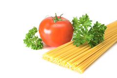 Pasta, tomato and parsley. On white background Royalty Free Stock Photography